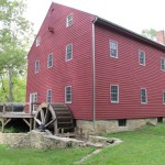 Back view with wheel at Historic Grinnell Mill Bed and Breakfast