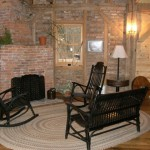 Sitting area around fireplace at Grinnell Mill Bed and Breakfast